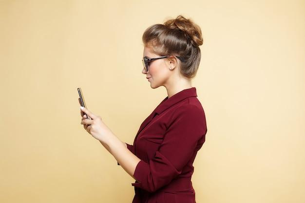 Beautiful girl posing in front of the camera. studio photo shoot.