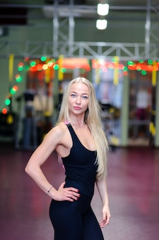 Beautiful girl posing in the gym
