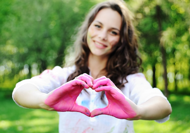 Beautiful girl put her hands in a heart shape