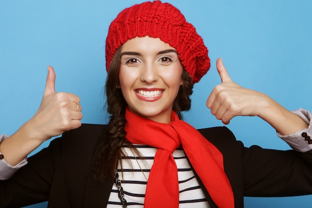 Beautiful girl in a red beret. french style.