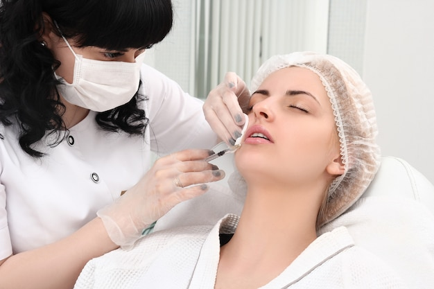 Beautiful girl on rejuvenation procedure in beauty clinic