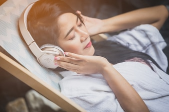 Beautiful girl relaxing beauty concept. happy girl smile anf listen to music with headphone