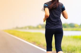 Beautiful girl running on road