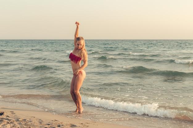 Beautiful girl at the sea posing