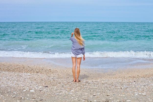 Beautiful girl in sea style on the adriatic beach