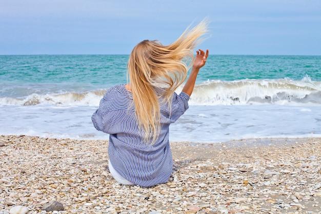 Beautiful girl in sea style on the adriatic beach.