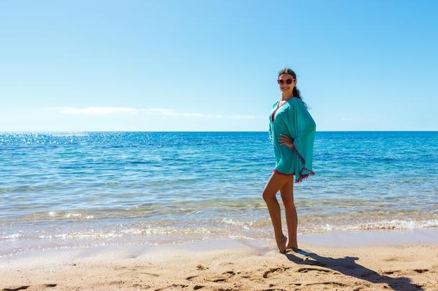 Beautiful girl in sea style having fun on a beach.