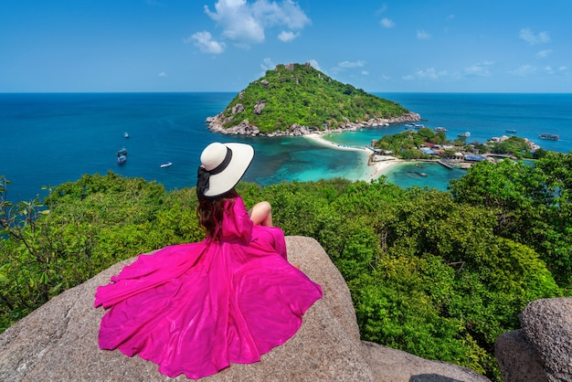 Beautiful girl sitting on viewpoint at koh nangyuan island near koh tao island, surat thaini in thailand