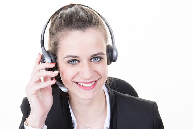 Beautiful girl smiling teleoperator with headset on head