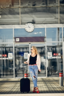 Beautiful girl standing in airport