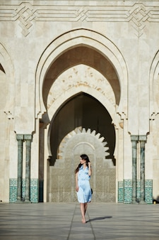 Beautiful girl standing near the hassan ii mosque