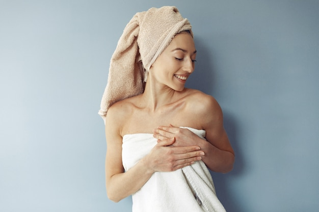 Beautiful girl standing  in a towel