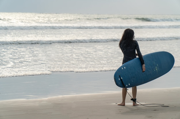 Beautiful girl on a surf board in the ocean