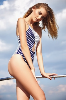 Beautiful girl in a swimsuit on a yacht Premium Photo