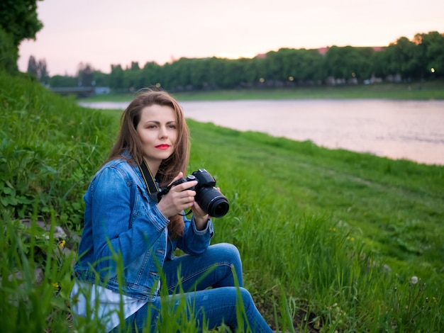 Beautiful girl tourist taking photos.