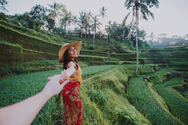 Beautiful girl visiting the bali rice fields in tegalalang, ubud. concept about people, wanderlust traveling and tourism lifestyle