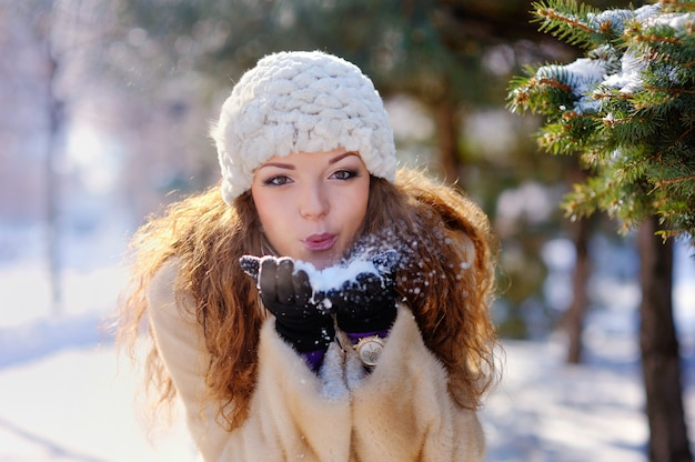 Beautiful girl on a walk in the park in winter
