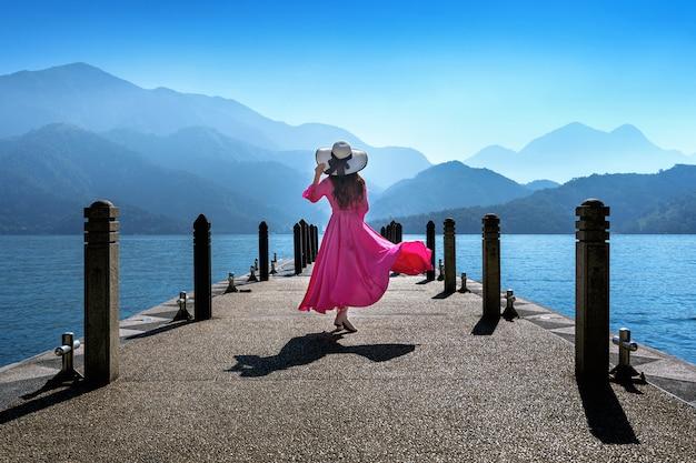 Beautiful girl walking at sun moon lake in taiwan.