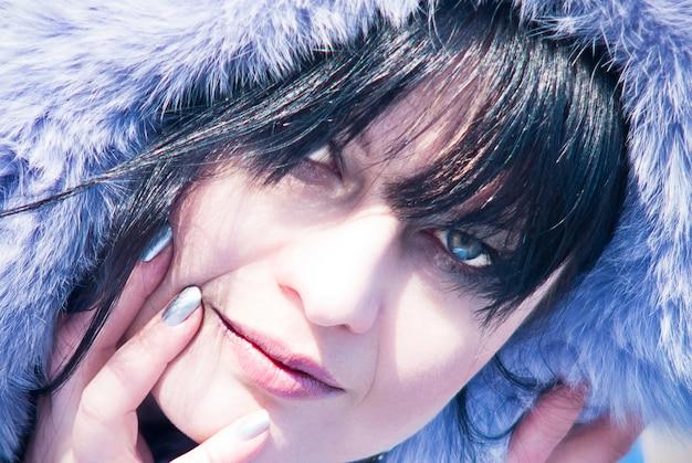 Beautiful girl winter portrait purple fur