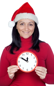 Beautiful girl with christmas hat and a clock on a over white background