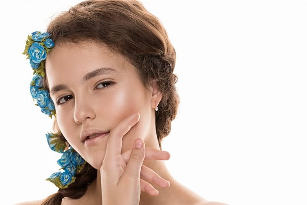 Beautiful girl with flowers in her hair, perfect skin. concept - personal care