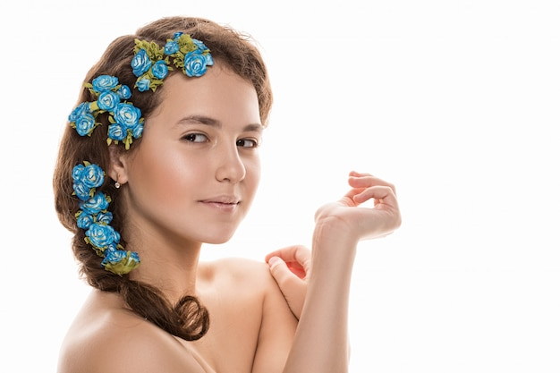 Beautiful girl with flowers in her hair.