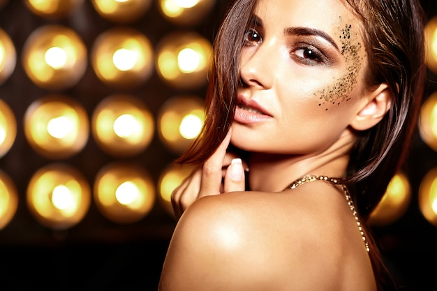 Beautiful girl with glitter on her face