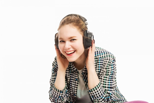 Beautiful girl with headphones laughing