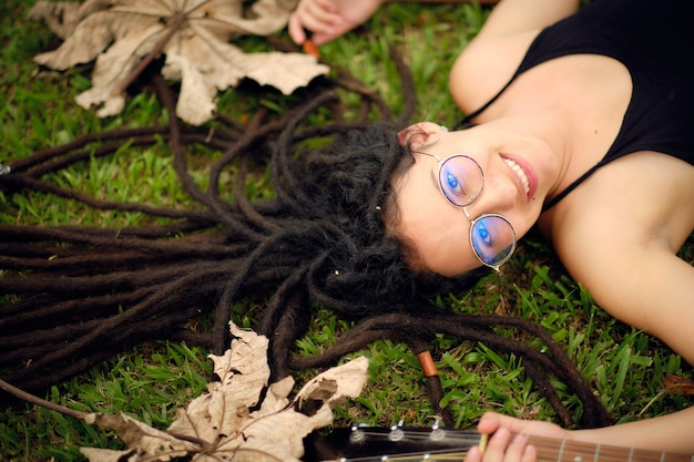 Beautiful girl with long dreadlocks and glasses.