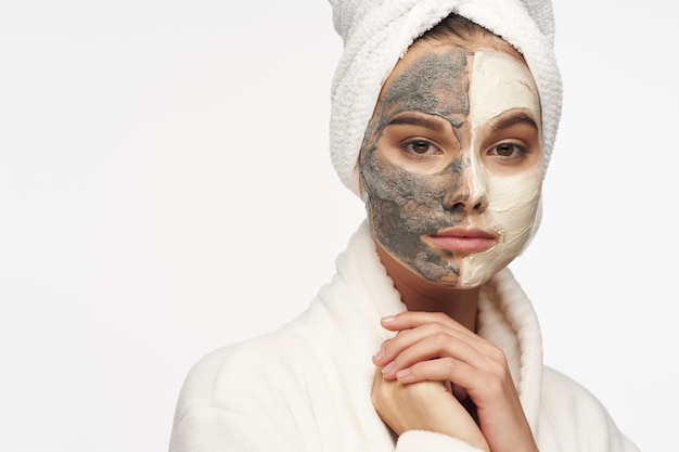 A beautiful girl with a mask against black dots on her face