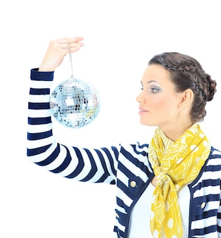 Beautiful girl with a mirror sphere on a white background.