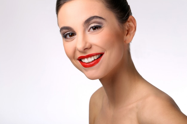 Beautiful girl with perfect skin and red lipstick