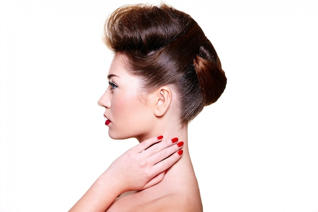 Beautiful girl with red lips and nails