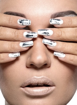 Beautiful girl with the silver metal nails.