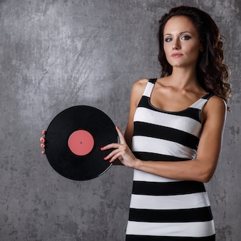 Beautiful girl with vinyl disc