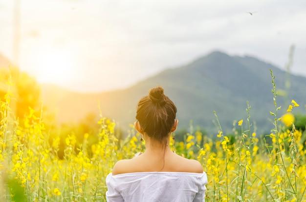 Beautiful girl in a yellow flower
