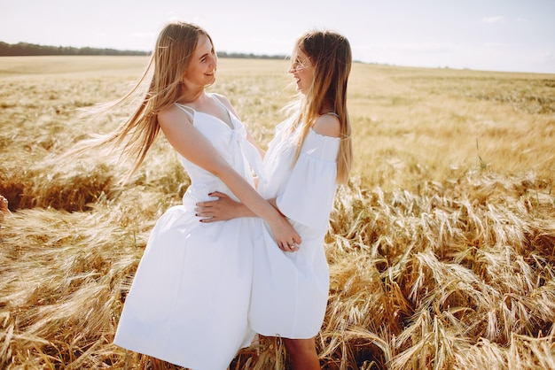 Beautiful girls in an autumn field
