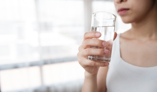 Beautiful girls drink water for good health, such as helping to digest food