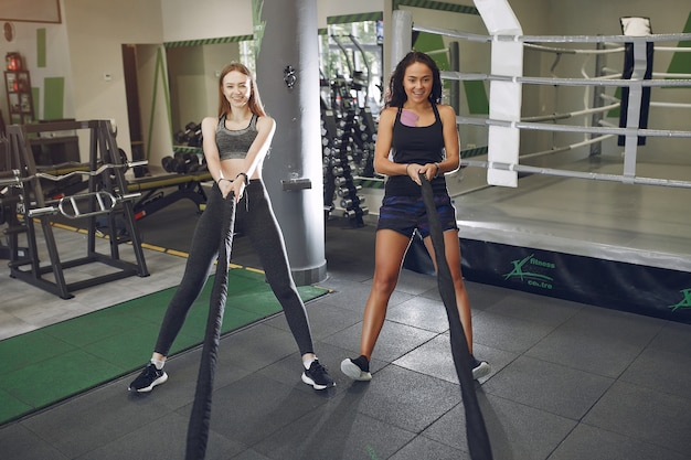 Beautiful girls in a gym. sports ladies in a sportswear. friends training