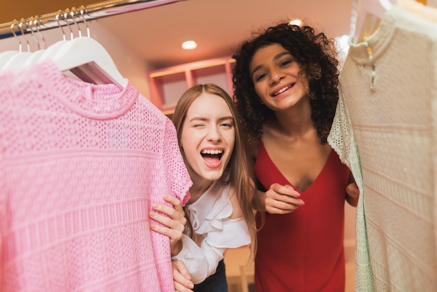 Beautiful girls have fun in the fitting room.