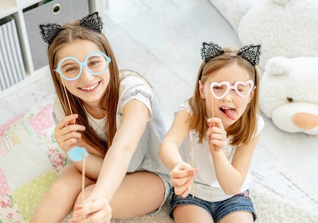 Beautiful girls having fun in playroom