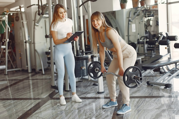 A beautiful girls is engaged in a gym