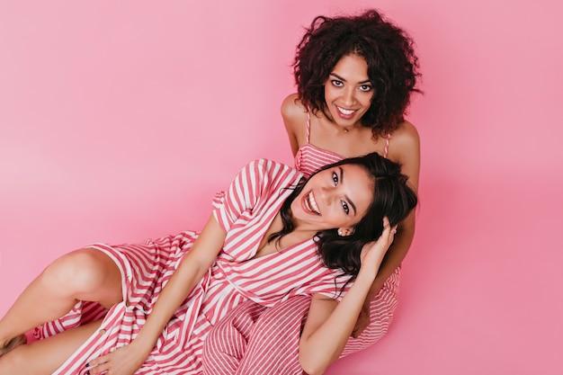 Beautiful girls posing in good mood and having fun