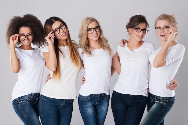 Beautiful girls wearing fashion glasses