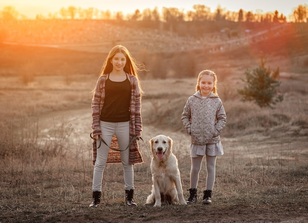 Beautiful girls with cute dog