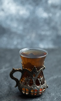 A beautiful glass cup with aroma tea .