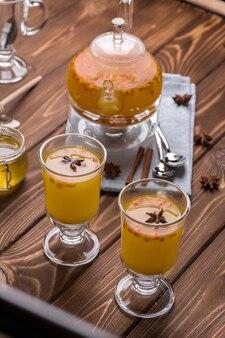 Beautiful glass teapot with orange sea buckthorn tea.