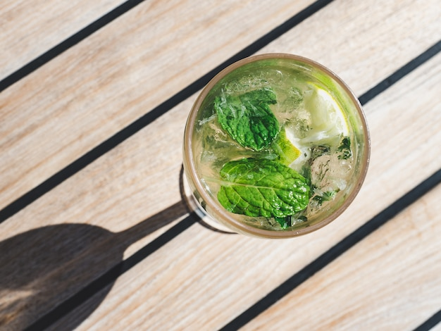 Beautiful glass with refreshing mojito and ice cubes