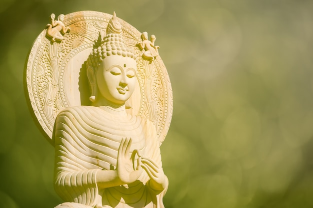 The beautiful golden buddha and golden bokeh