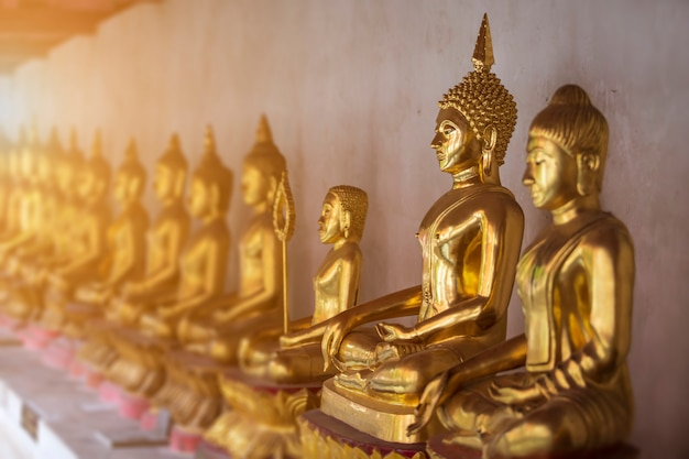 Beautiful golden buddha statues at buddhist temple